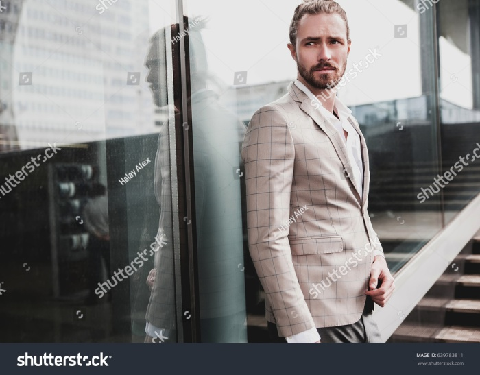 stock-photo-portrait-of-sexy-handsome-fashion-male-model-man-dressed-in-elegant-beige-checkered-suit-posing-on-639783811